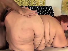 Huge BBW Has a Pecker Stuffed in Her Cakehole and Twat